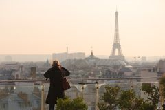 Woman taking the Eiffel tower in photo Royalty Free Stock Photo