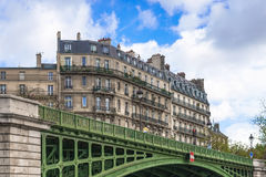 Paris, France - May 1, 2017: Ancient architecture along the bank. S of the Seine, close to Pont Sully Bridge on May 1, 2017, at Paris,  France Stock Photography
