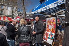 PARIS, FRANCE - MAY 1 2016 - Artist and tourist in Montmartre Stock Photos