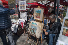 PARIS, FRANCE - MAY 1 2016 - Artist and tourist in Montmartre Royalty Free Stock Photo