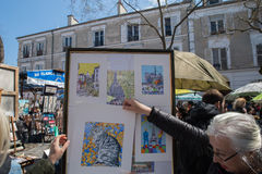 PARIS, FRANCE - MAY 1 2016 - Artist and tourist in Montmartre Stock Image