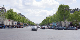 Champs Elysees. On the roadway moving cars, pedestrians-on side. Paris; France- May 01; 2017: Champs Elysees. On the roadway moving cars, pedestrians-on royalty free stock photo