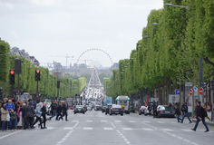 Champs Elysees. On the roadway moving cars, pedestrians-on sid Stock Photography