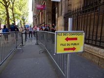 Barricades and lines for convicts, Palais de Justice, Paris, France. PARIS, FRANCE - MAY  7, 2018: Close-up of a sign and barricades separating the entrance for stock photo