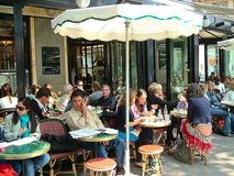 Cafe de Flore in Paris, France. Paris, France - May 4, 2007: The famous Cafe de Flore at the corner of Saint-Germain boulevard and Saint-Benoit street. The place stock image