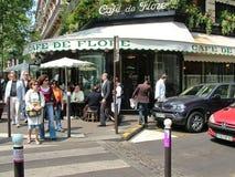 Cafe de Flore in Paris, France. Paris, France - May 4, 2007: The famous Cafe de Flore at the corner of Saint-Germain boulevard and Saint-Benoit street. The place stock photo