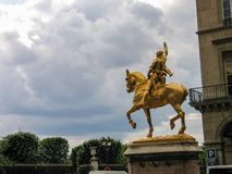 Golden equestrian statue of Jeanne d`Arc. PARIS, FRANCE - MAY 30, 2006: Golden equestrian statue of Joan of Arc or Jeanne d`Arc with empty flagpole on May 30 Stock Image