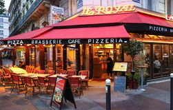 Le Royal is traditional French cafe located on Boulevard de Port Royal in Paris. Paris , France-May 19, 2019 : Le Royal is traditional French cafe located on royalty free stock photos