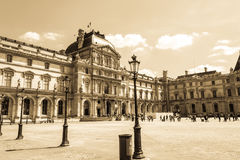 Paris, France - MAY 27, 2015: The Louvre in Paris on a sunny day. Old retro style. Paris, France - MAY 27, 2015: The Louvre in Paris on a sunny day with blue stock photography