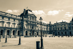 Paris, France - MAY 27, 2015: The Louvre in Paris on a sunny day. Old retro style. Paris, France - MAY 27, 2015: The Louvre in Paris on a sunny day with blue royalty free stock images