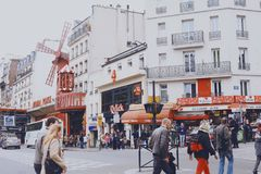 PARIS, FRANCE - May 16, 2013: Moulin Rouge - the famous cabaret in Paris, built in 1889 and located in the red light district of P Royalty Free Stock Images