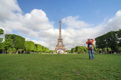 Paris, France - May 15, 2015: People visit the Champs de Mars  at the foot of the Eiffel Tower in Paris Stock Images