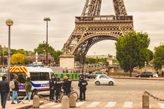 Police truck is parked in the street in front of the eiffel towe. PARIS, FRANCE - May 08, 2017 : police truck is parked in the street in front of the eiffel Royalty Free Stock Photos