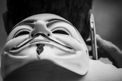 Portrait of man with Vendetta mask and telephone in outdoor royalty free stock photo