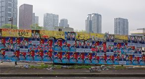 Pre-election advertising on the fence on President Kennedy`s Ave. Paris; France-May 05; 2017: Pre-election advertising on the fence on President Kennedy`s Avenue Stock Image