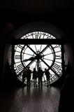 Paris, France - May 14, 2015: Silhouettes of unidentified tourists in the museum D'Orsay. Stock Photo