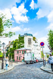 Paris, France - May 27, 2015: street in paris in the Montmartre area on a sunny day with green trees and a blue sky. The Montmartre - one of the most famous Stock Image