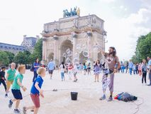 Paris, France. May 2018. A street performance makes soap bubbles royalty free stock image