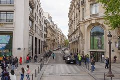 There are people walking along the Champs Elysees and Bossano St. Paris; France- May 01; 2017: There are people walking along the Champs Elysees and Bossano stock images