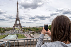 PARIS, FRANCE - MAY 2, 2016: Tourist taking pictures at Tour Eiffel town symbol Royalty Free Stock Photo