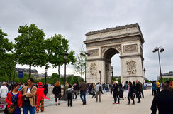 Paris, France - May 14, 2015: Tourist visit Arc de Triomphe de l'Etoile in Paris. Arc de Triomphe was built in 1806-1836 by architect Jean Shalgrenom by order Royalty Free Stock Photos