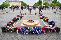 Paris, France - May 14, 2015: Tourist visit Tomb of the Unknown Soldier beneath the Arc de Triomphe. Paris. on May 14, 2015 Royalty Free Stock Photography