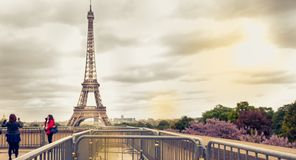 Tourists are taking pictures in front of the Eiffel Tower royalty free stock photo