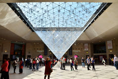 Paris, France - May 13, 2015: Tourists visit Inside the Louvres pyramid Royalty Free Stock Images