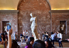 Paris, France - May 13, 2015: Tourists visit The Venus de Milo statue at the Louvre Museum Stock Photography