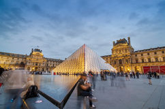 Paris, France - May 14, 2015: Tourists visiting Louvre museum at Dusk Royalty Free Stock Image