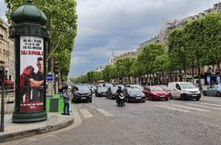 Traffic on the Champs-Elysees in Paris, France. Paris, France - May 13, 2018: Traffic of cars wait on the Avenue des Champs-Elysees in Paris, France on May 13 royalty free stock photos