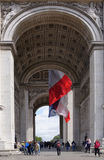 Triumphal arch on the Champs Elysees. Tourists inspect it and t. Paris; France- May 01; 2017: Triumphal arch on the Champs Elysees. Tourists inspect it and take stock photos