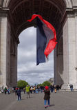 Triumphal arch on the Champs Elysees. Tourists inspect it and t. Paris; France- May 01; 2017: Triumphal arch on the Champs Elysees. Tourists inspect it and take royalty free stock photo