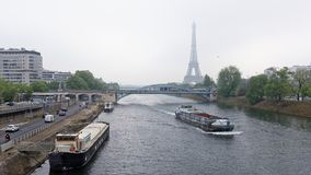 View of the Grenelle Bridge. On the embankment are moving cars a Stock Image