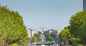 View of Paris and the Arc de Triomphe. Paris, France - May 09, 2017 : view of Paris and the Arc de Triomphe from the Defense business district in the spring Stock Images