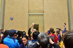 Paris, France - May 13, 2015: Visitors take photos of Leonardo DaVinci's  Royalty Free Stock Photography