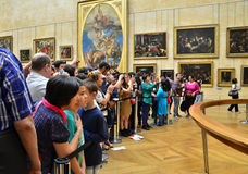 Paris, France - May 13, 2015: Visitors take photos of Leonardo DaVinci's Mona Lisa at the Louvre Museum royalty free stock photo
