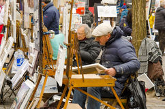 PARIS, FRANCE, MONMARTRE, ARTISTS. PARIS, FRANCE ,artists create and sell their artworks on Place du Tertre in Montmartre. The area once attracted famous modern Stock Photography