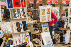 PARIS, FRANCE, MONMARTRE, ARTISTS. PARIS, FRANCE, artists create and sell their artworks on Place du Tertre in Montmartre. The area once attracted famous modern Stock Images
