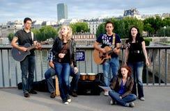 Paris, France: Musicians on Pont des Arts. A group of musicians performing on the Pont (bridge) des Arts over the Seine River during the Fête de la Musique ( Stock Photography