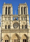 Notre Dame Cathedral. Paris, France. Gothic facade with sun light. Sunny day, blue sky. stock photos