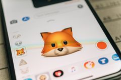 Fox animal 3d animoji emoji generated by Face ID facial recognit. PARIS, FRANCE - NOV 9 2017: Fox animal 3d animoji emoji generated by Face ID facial recognition Royalty Free Stock Images