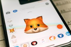 Ox animal 3d animoji emoji generated by Face ID facial recogniti. PARIS, FRANCE - NOV 9 2017: Fox animal 3d animoji emoji generated by Face ID facial recognition Royalty Free Stock Photography