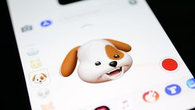 Dog Pet 3d animoji singing on Apple iPhone X. PARIS, FRANCE - NOV 4 2017: Funny Dog 3d animoji emoji generated by Face ID facial recognition system with stock video footage