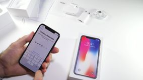 Man unbox the latest iPhone x activation stock footage