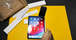Man unboxing setting latest Apple Pencil 2 stock video footage