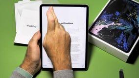 Man unboxing unpacking new Apple Computers iPad Pro