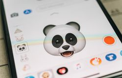 Panda bear 3d animoji emoji generated by Face ID facial  iphone. PARIS, FRANCE - NOV 9 2017: Panda bear 3d animoji emoji generated by Face ID facial recognition Stock Photography