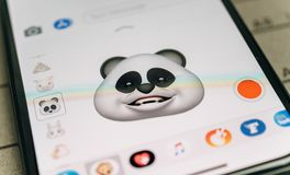 Panda bear 3d animoji emoji generated by Face ID facial  iphone. PARIS, FRANCE - NOV 9 2017: Panda bear 3d animoji emoji generated by Face ID facial recognition Stock Image