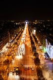 Paris, France - Nov 2017: Aerial view of the famous Champs Elysees from the top of Arc de Triomphe at night. Paris, France - November 2017: Aerial view of the Royalty Free Stock Photos